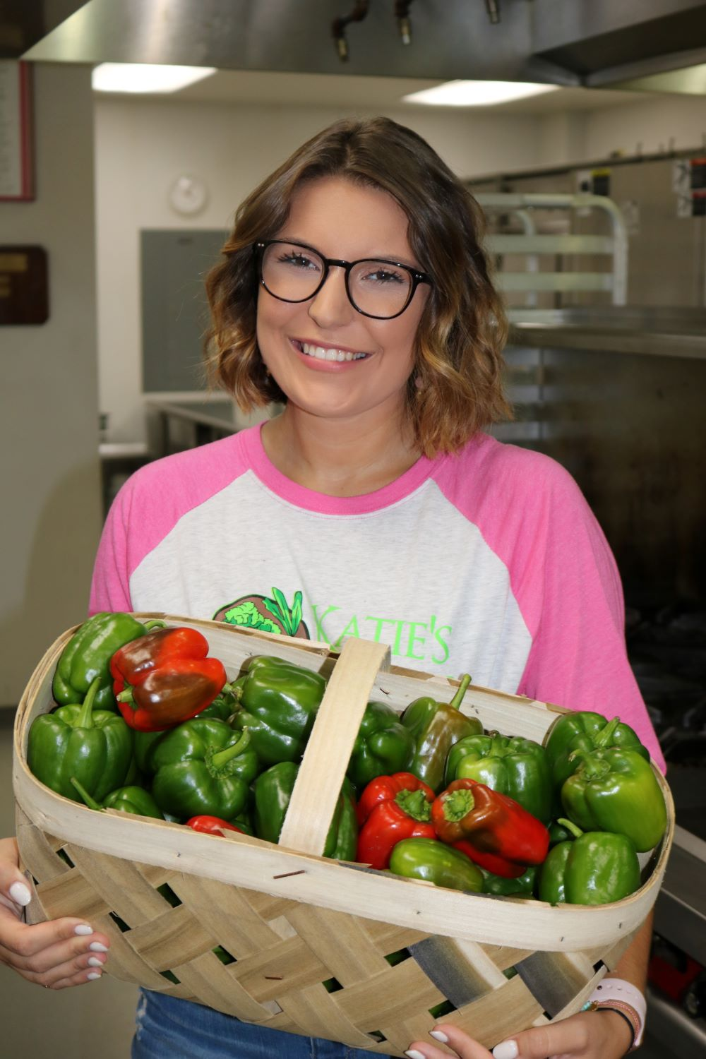 katie stagliano with vegetables to help food insecurity