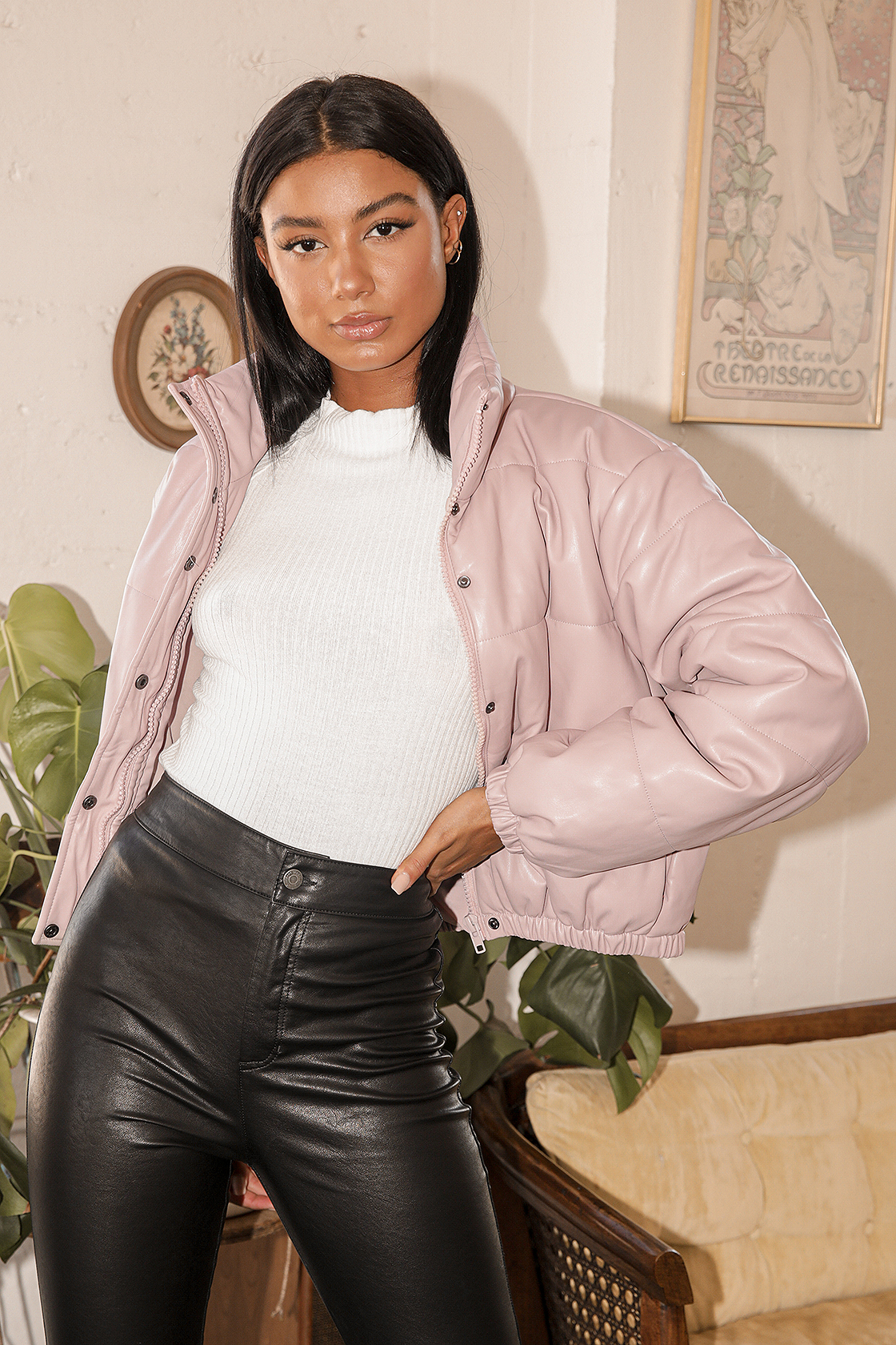 model in pink mauve vegan leather puffer jacket and black pants