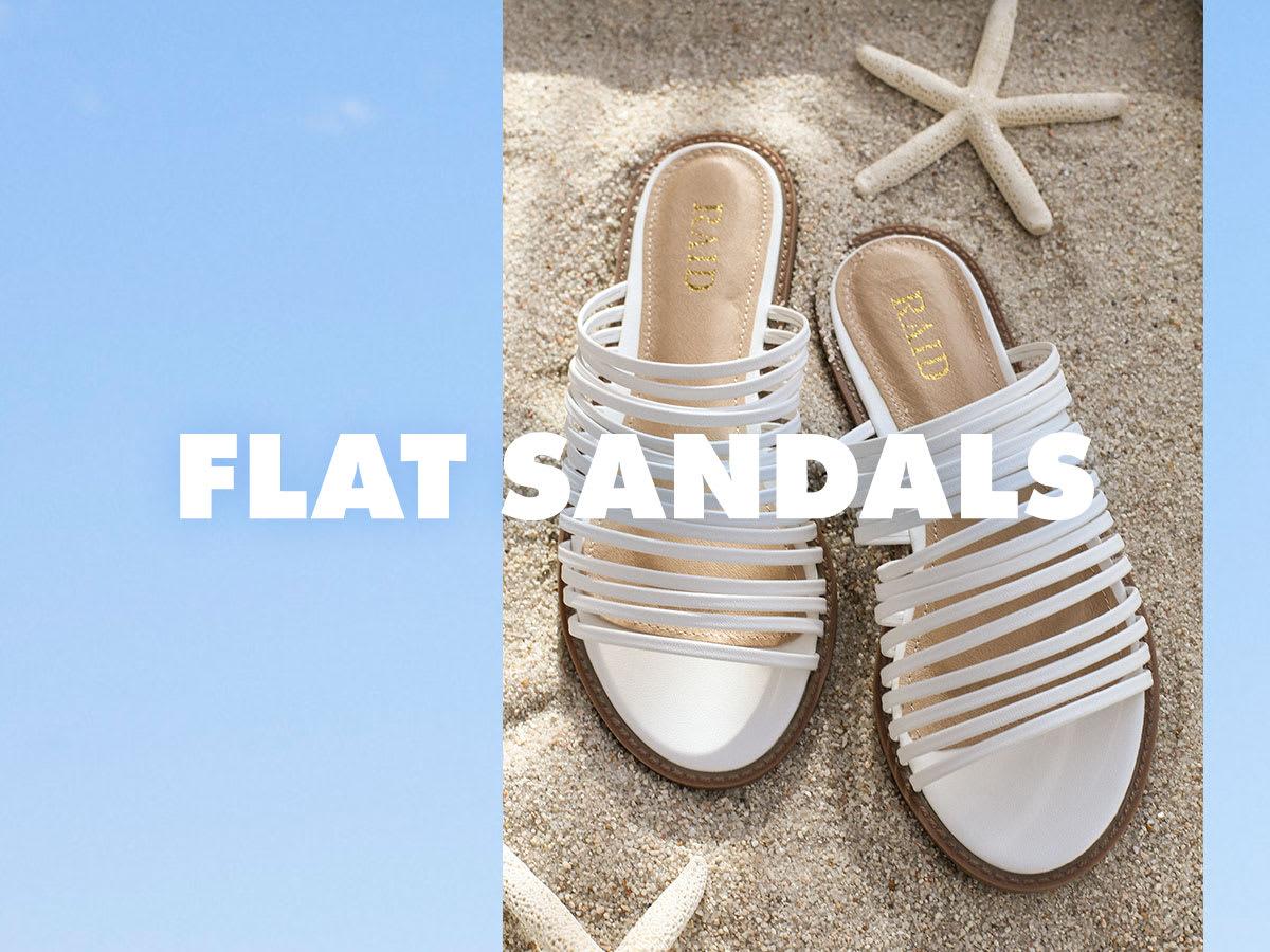 bd9c15122 beach display of white strappy slide sandals