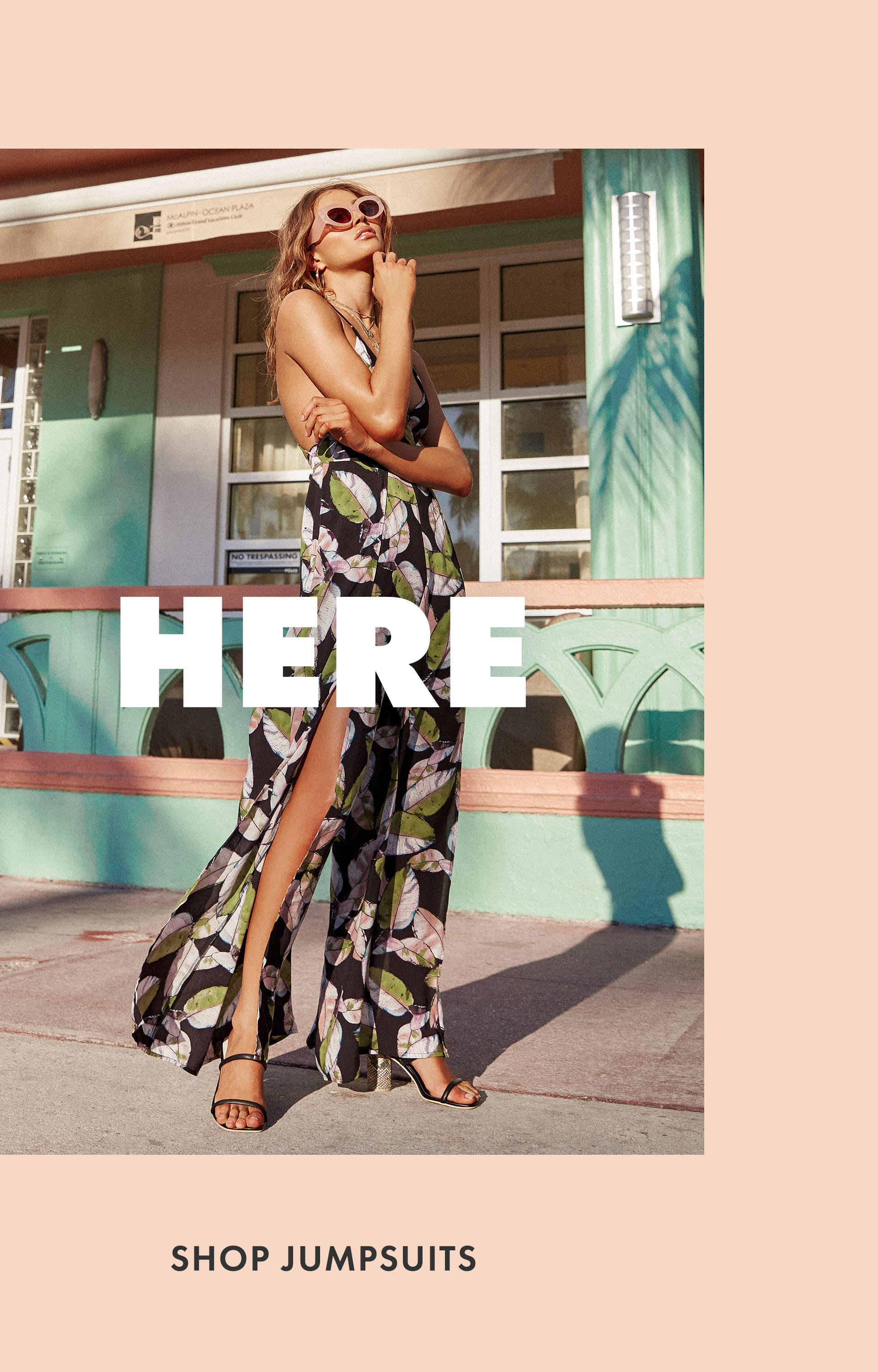 d991f97ac14f ... model in black floral fly away pant jumpsuit and pink cat eye sunnies