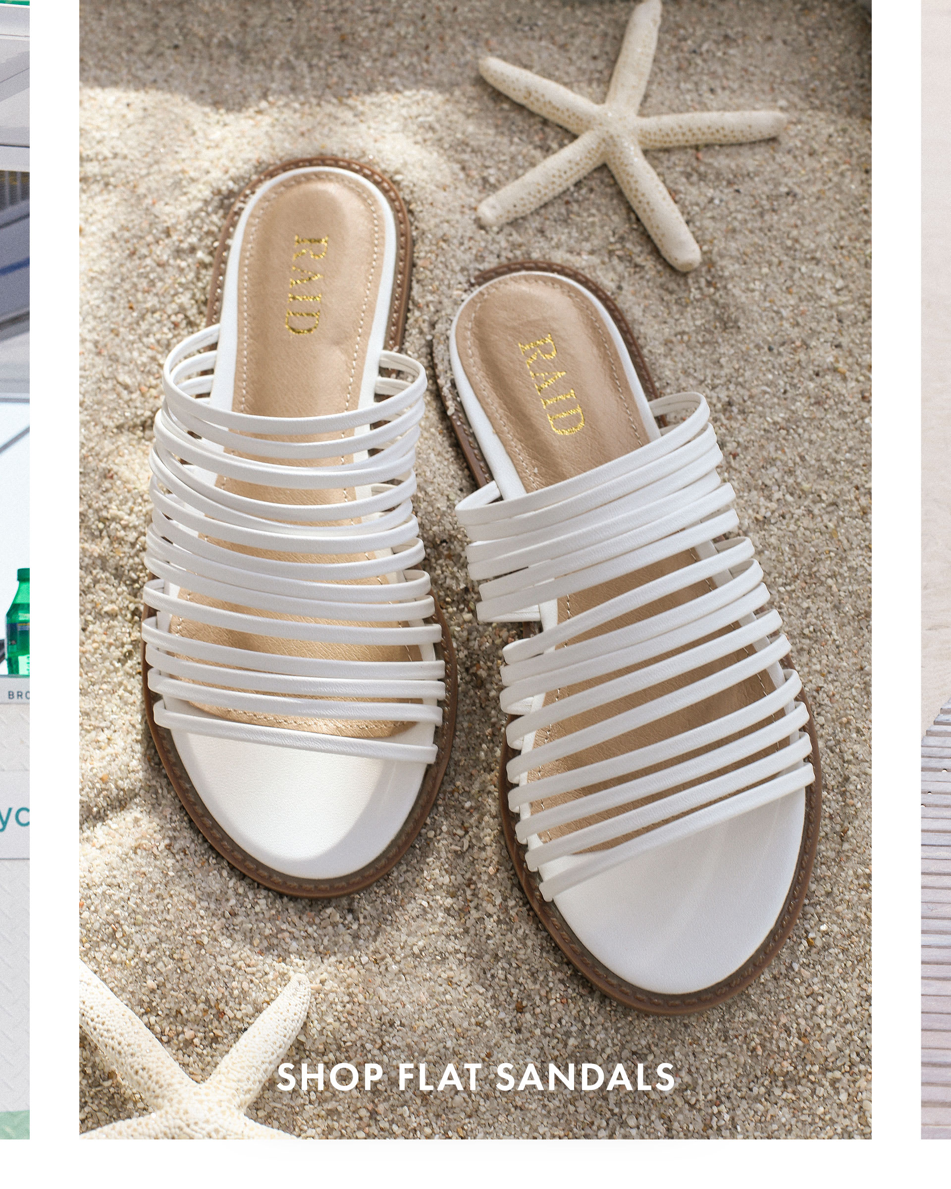2638367a6 ... beach display of white strappy slide sandals ...