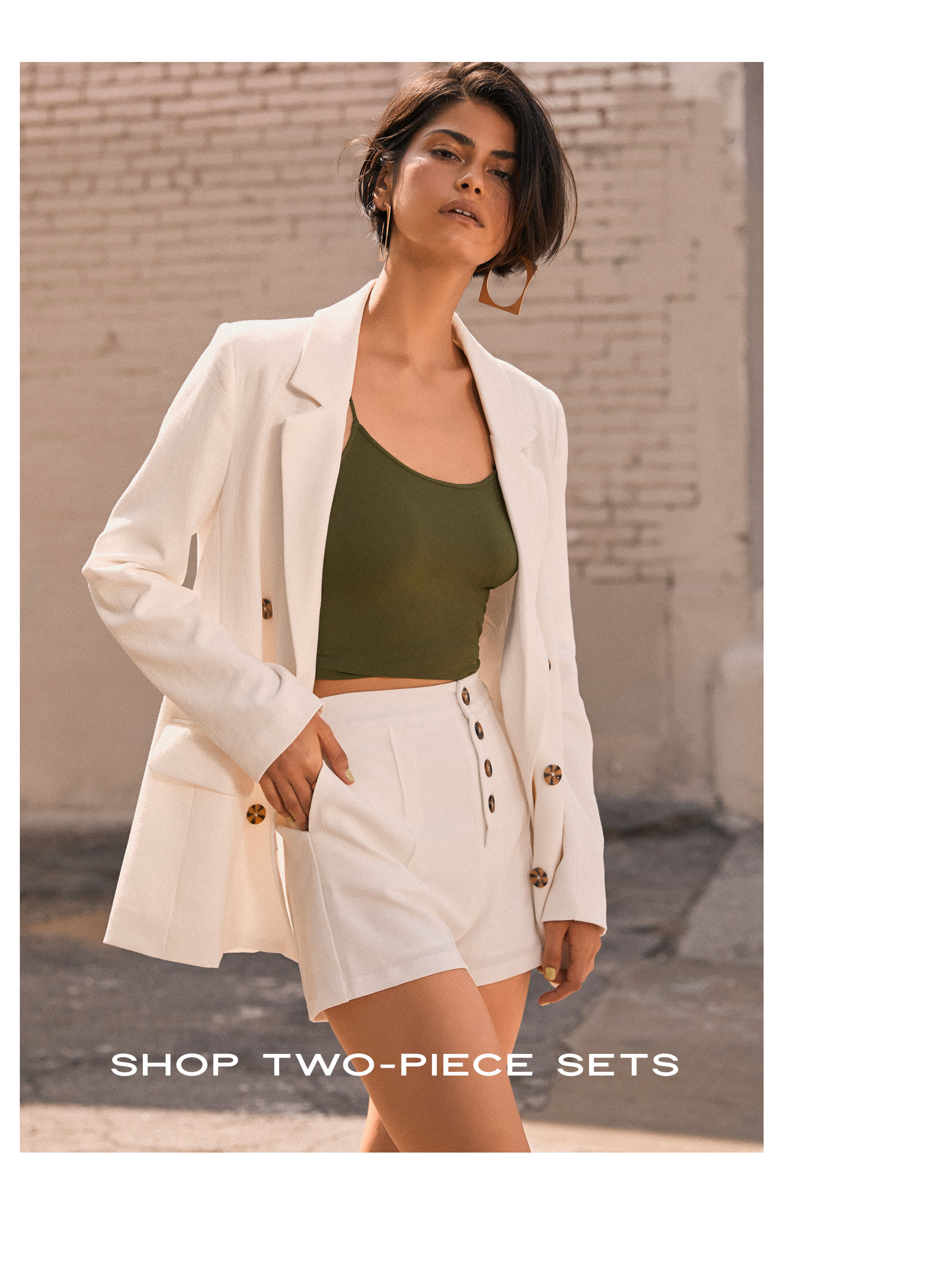 6c7fd333f ... Model in green crop cami and white blazer and shorts two-piece set