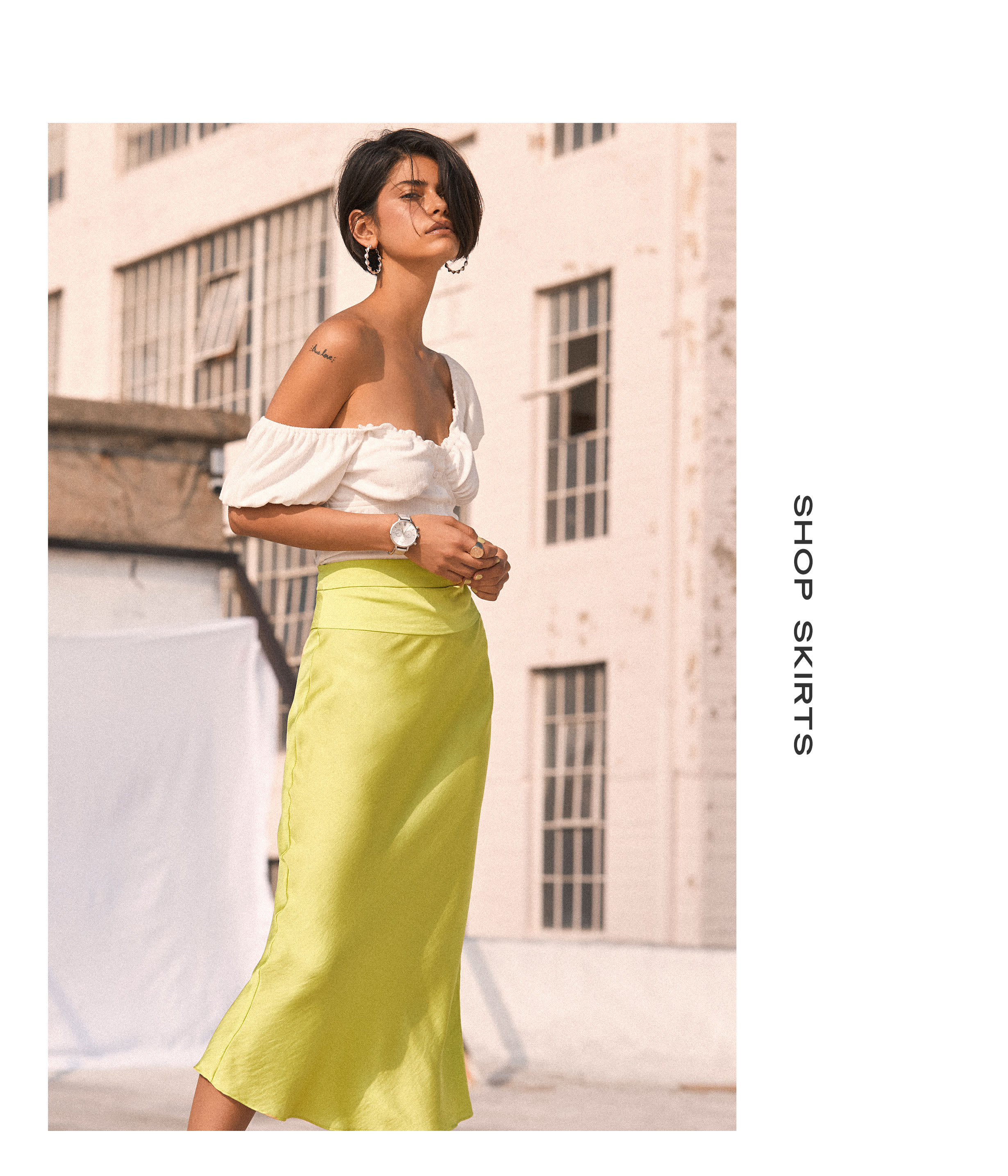 804e1908908e Model in plunging white lace bodysuit and wide leg pants Model in white top  and a high waisted neon yellow satin midi skirt