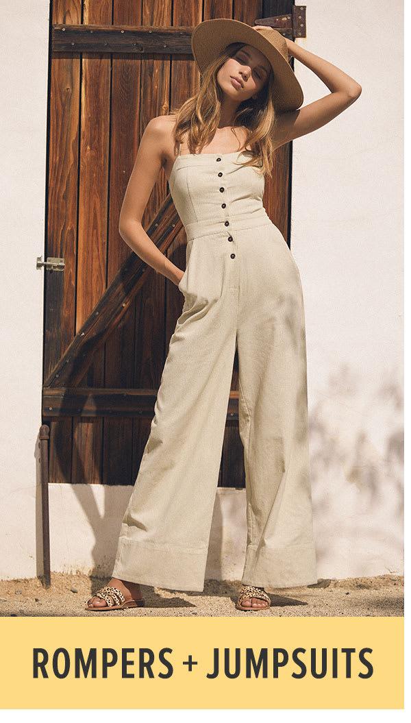 8ffa61d278de model in beige wide leg jumpsuit and straw hat ...