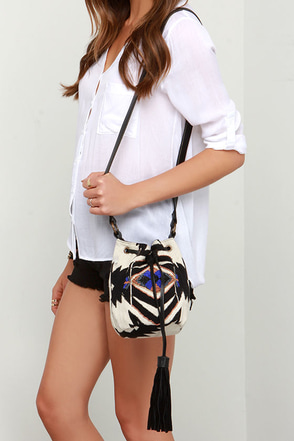 Turn up the Music Beige and Black Leather Drawstring Purse at Lulus.com!