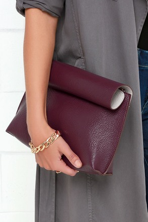 Bend the Rolls Reversible Burgundy Clutch at Lulus.com!
