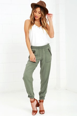 On the Road Aniston Washed Olive Green Jogger Pants at Lulus.com!