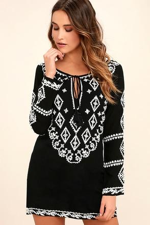 Tight black long sleeve dress