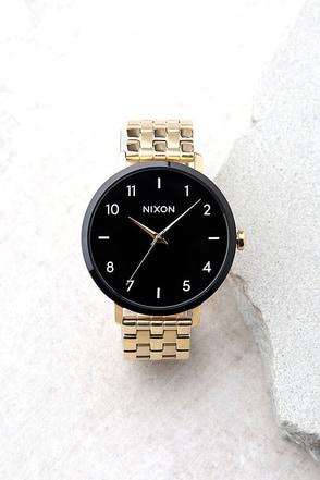 Nixon Arrow Gold, Black, and White Watch 1