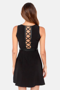 Rock Around the Frock Cutout Black Dress at Lulus.com!