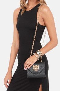 Sooner Roar Later Black Tiger Clutch at Lulus.com!