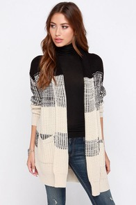 There and Back Again Black and Beige Sweater at Lulus.com!