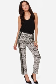 Where It's At Ivory and Black Print Cropped Pants at Lulus.com!