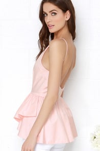 In the Trend Light Peach Backless Peplum Top at Lulus.com!