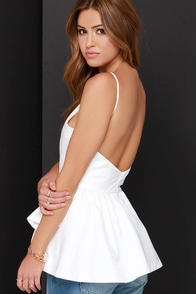 In the Trend Ivory Backless Peplum Top at Lulus.com!