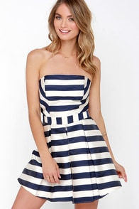 Sweet Like Honey Navy Blue Striped Strapless Romper at Lulus.com!