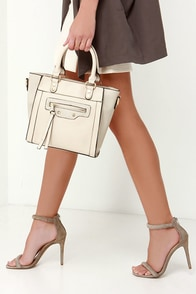 On the Wing Light Beige Handbag at Lulus.com!