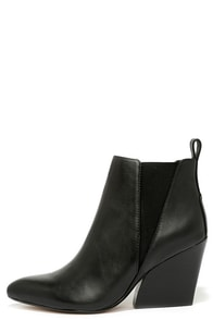 Report Signature Myrna Black Leather Wedge Booties at Lulus.com!
