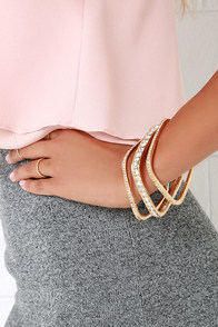 Square's Fair Gold Rhinestone Bangle Set at Lulus.com!