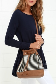 Carefree as Can Be Ivory and Navy Blue Striped Bucket Bag at Lulus.com!
