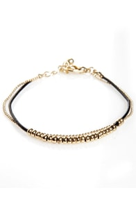 Double Trouble Black and Gold Bracelet at Lulus.com!