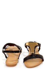 Darlene 5 Black Gold Plated T-Strap Sandals at Lulus.com!