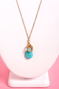 Three Ring Circlets Blue Pendant Necklace at Lulus.com!