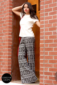 Billabong Heart of Gems Bell-Bottom Black Print Pants at Lulus.com!