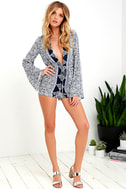 Many Moons Ivory and Navy Blue Floral Print Romper 3