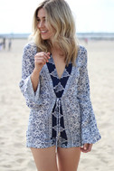 Many Moons Ivory and Navy Blue Floral Print Romper 9