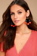 Ablaze Black and Orange Pom Pom Earrings 1