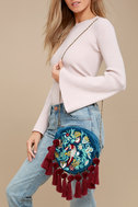 Flying Colors Teal Blue Embroidered Circle Clutch