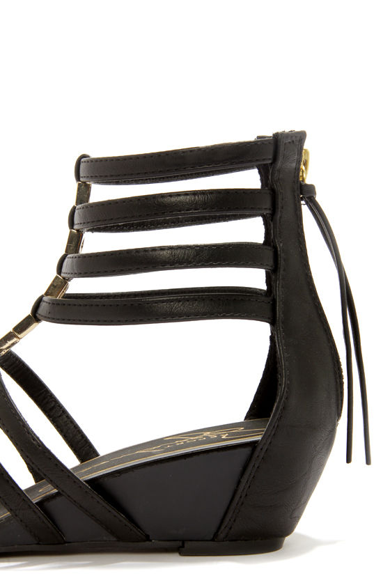 Report Meliza Black and Gold Caged Wedge Sandals at Lulus.com!