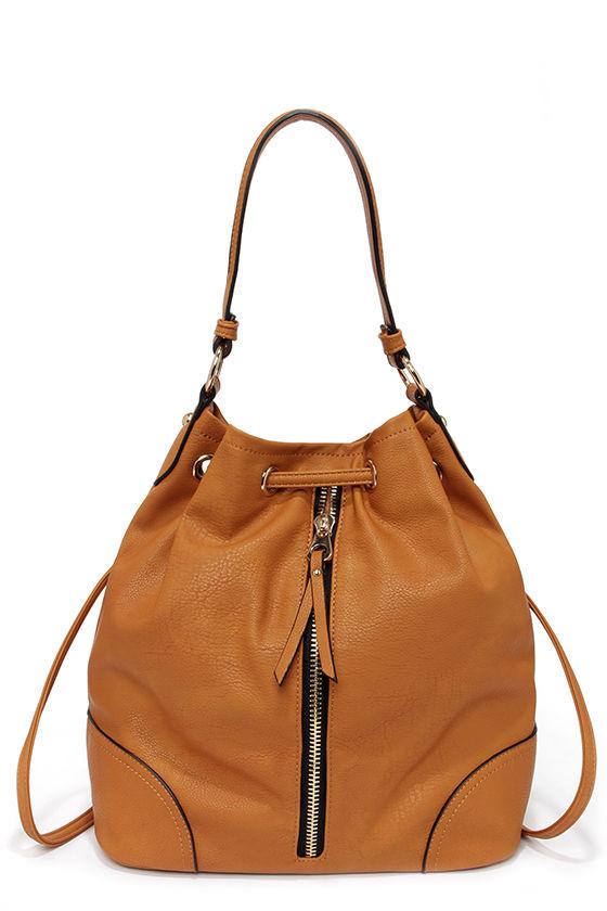 tan purse backpack
