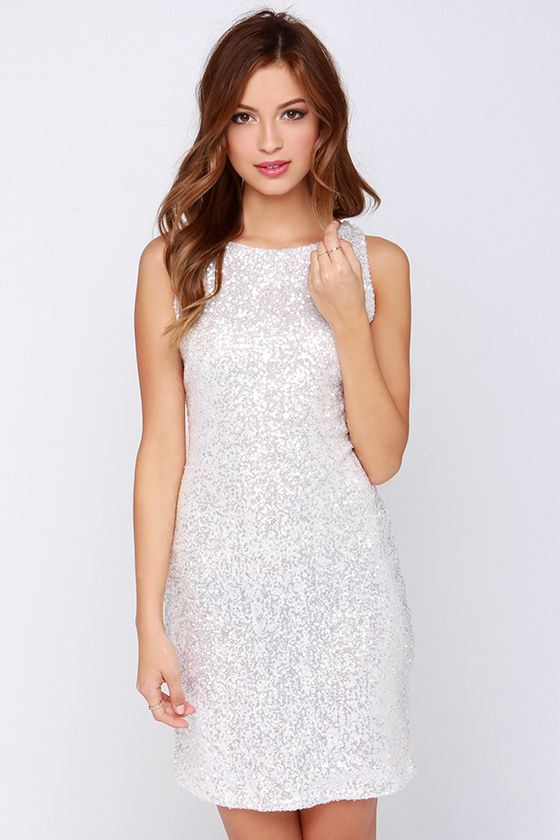 Shop long white dresses with sequins and spaghetti straps at PromGirl. Long sequin embellished white dresses and white v-neck prom dresses.