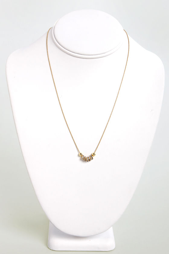 Rings True Gold Rhinestone Necklace at Lulus.com!