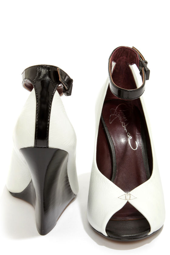 Report Signature Londyn White and Black Ankle Strap Wedges at Lulus.com!