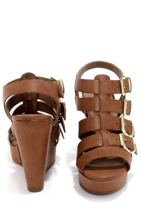 Madden Girl Kloverrr Cognac Buckled Wedge Sandals at Lulus.com!