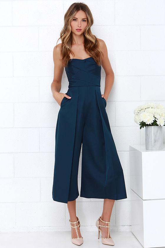 Kat Tanita of With Love From Kat wears a navy blue strapless silk jumpsuit in Soho.