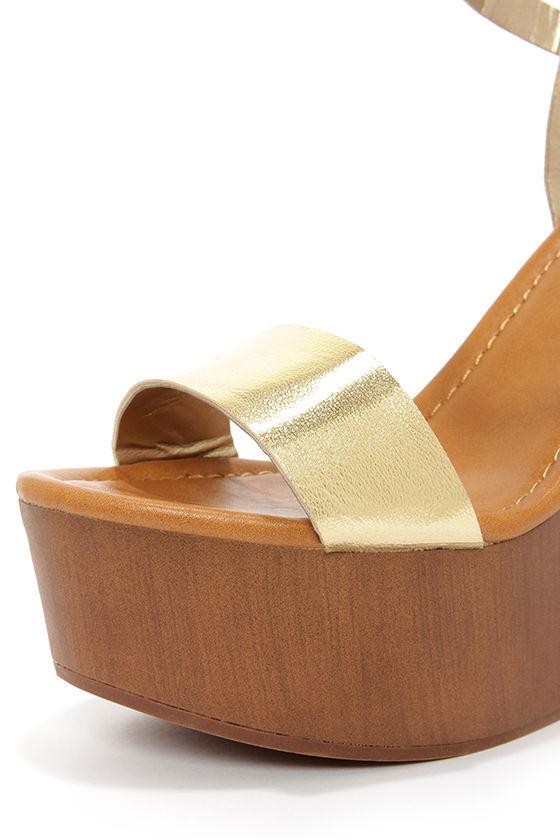 Emily 34 Gold Platform Wedge Sandals at Lulus.com!