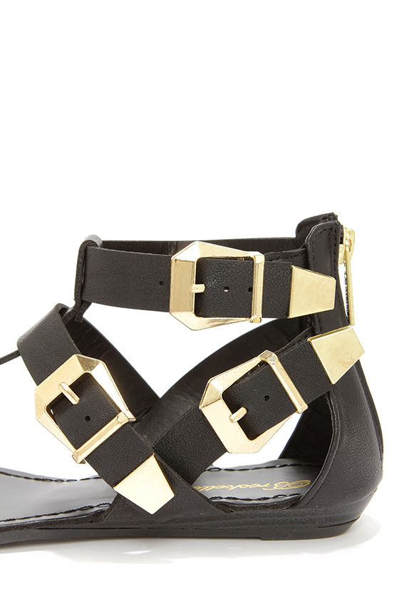 Vivian 33 Black and Gold Buckled Thong Sandals at Lulus.com!