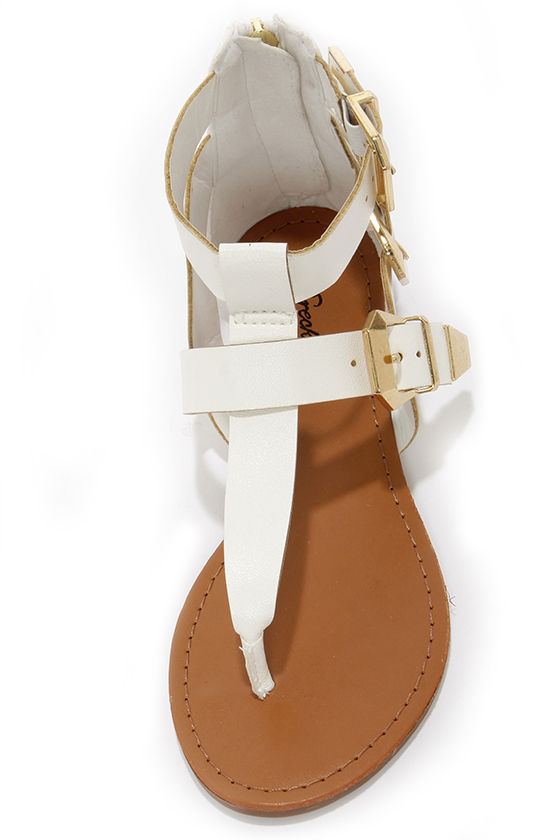 Vivian 33 White and Gold Buckled Thong Sandals at Lulus.com!