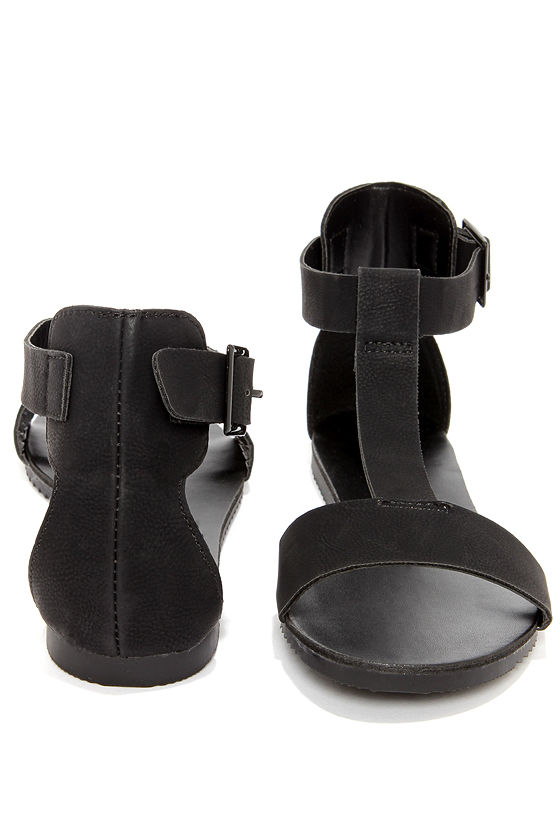 Joy 12 Black T Strap Flat Sandals at Lulus.com!