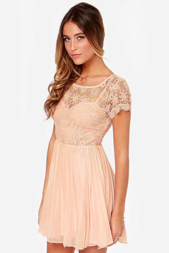 A warm and energetic color, peach dresses have become a part of the neutral color family. Browse through our peach homecoming dresses and find the perfect dress that suits your style and personality.