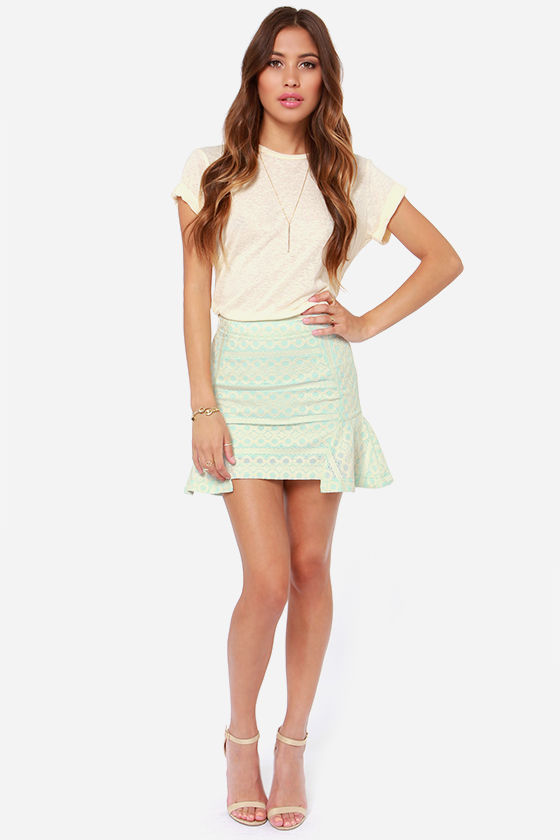 If you are looking for a perfect spring style pencil skirt, Empra should be among your list of choices. This classy mid-length pencil skirt has a lace overlay as well as .