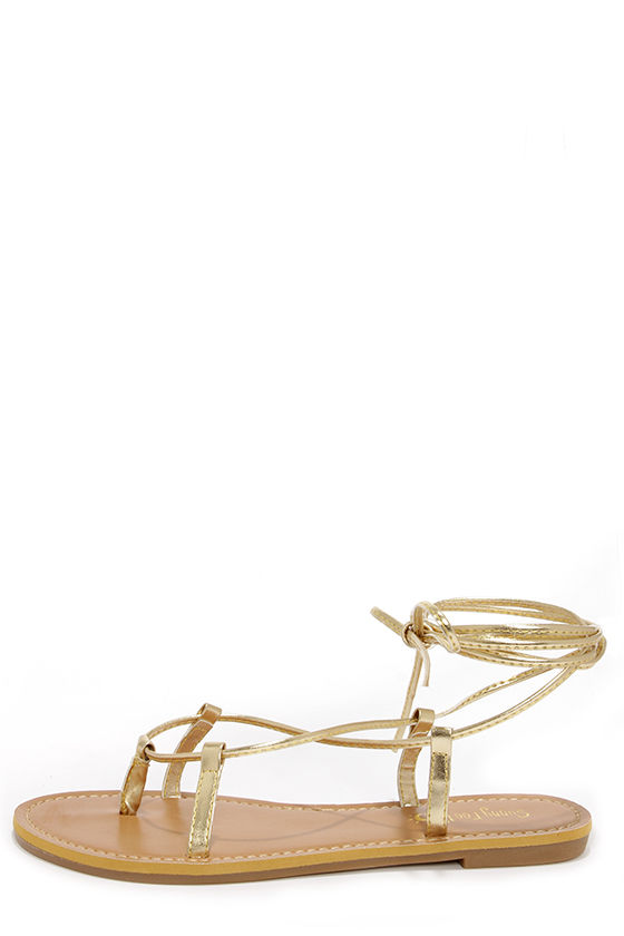 Armin 24 Gold Leg Wrap Sandals at Lulus.com!