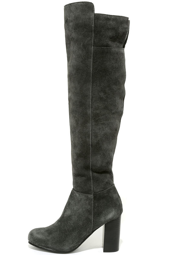 My Favorite Knee High Suede Boots Gray spice up any Fall or Winter outfit. Pair with jeans or leggings. Carly is pictured wearing a size 9. Please note color could be different in person and on other devices.