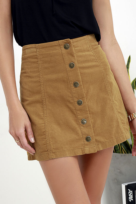 Online only! The coolness of cord is totally back, so make a move in this adorable corduroy mini skirt! Button-up placket tops a full A-line shape with sleek center seams.