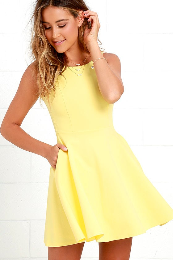 Rain or shine, the Sunshine Seasons Yellow Lace Skater Dress is sure to be a number that will brighten your day! Bright yellow lace tops a woven ivory lining, starting with a rounded neckline that fastens at back with an exposed silver zipper.