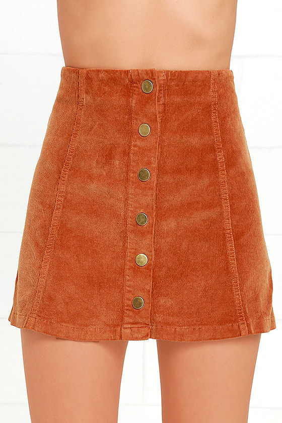 This soft mini skirt is designed with a full snap front from a golden brown corduroy fabric. Shop rue21!